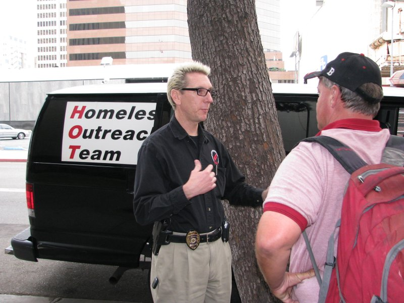 San Diego Police officer Timothy Burns tries to convince a man named Joe to e...