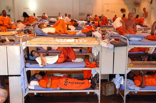 Prisoners lay on their bunks at California State Prison in Los Angeles County...
