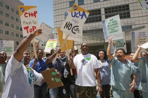 University of California employees represented by the Union Coalition demonstrate in front of UCLA Ronald Reagan Medical Center to call on University of California executives take a pay cut instead of reducing services to patients, cutting employee hours and increasing student tuition on July 15, 2009 in the Westwood area of Los Angeles, California.