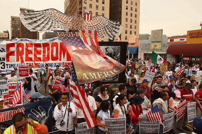 Demonstrators rally for immigrant worker rights on May Day, May 1, 2009 in Lo...
