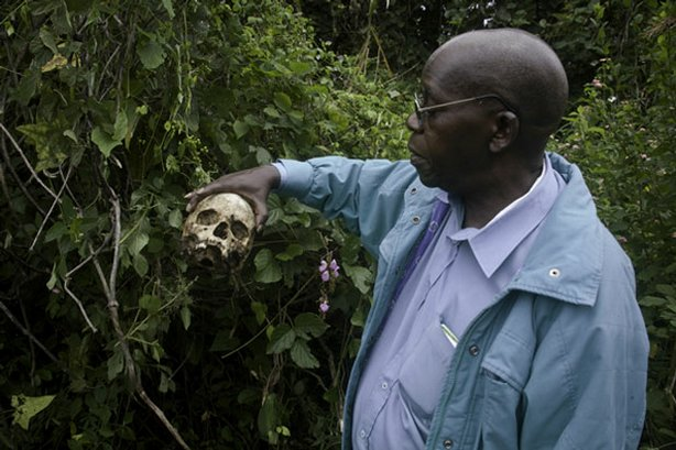 This documentary follows dynamic International Criminal Court ICC prosecutor Luis Moreno-Ocampo and his team for three years across four continents as Moreno-Ocampo issues arrest warrants. Pictured: Professor Pilo inspecting a skull in the killing fields of Bogoro, Ituri, eastern Congo.