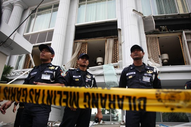 Police stand guard over the bombed hotel frontage following this morning's bomb blast at the Ritz-Carlton hotel on July 17, 2009 in Jakarta, Indonesia. Jakarta was rocked by 2 apparent bombs at the Ritz Carlton and also the Marriott hotel.