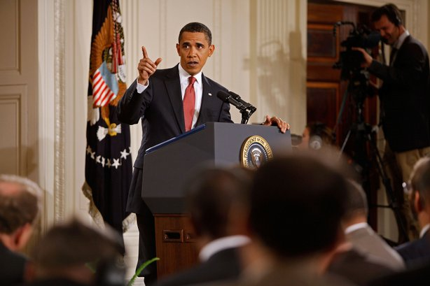 U.S. President Barack Obama answers a question during a news conference in th...
