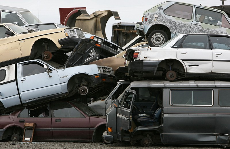 Junk cars are seen stacked at Deal Auto Wrecking July 31, 2009 in Richmond, C...