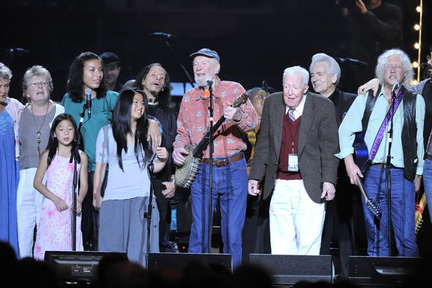 Pete Seeger (center) celebrates his 90th birthday surrounded by friends.