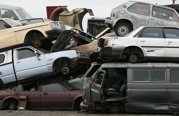 Junk cars are seen stacked at Deal Auto Wrecking July 31, 2009 in Richmond, California.