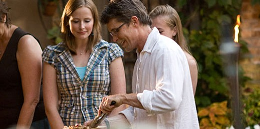 Rick Bayless serving food to his guests.