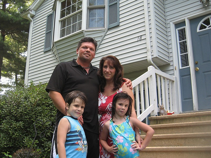 The Crochetiere family in front of their home in Springfield, Mass. Ron and S...