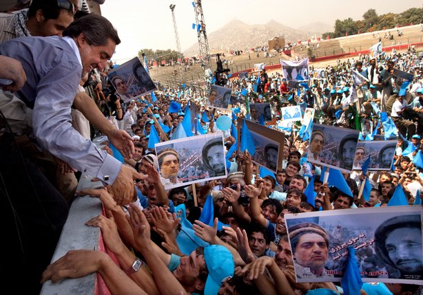 Supporters reach out to shake hands with Presidential hopeful Abdullah Abdull...
