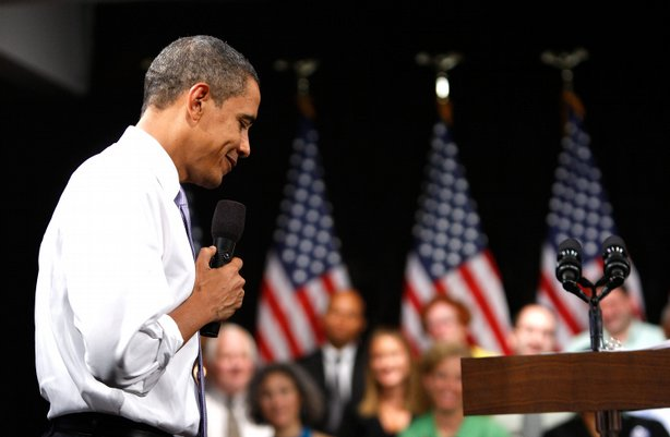 President Barack Obama pauses during a town hall meeting on health care at th...