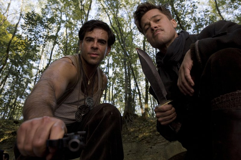 Eli Roth and Brad Pitt administering justice
