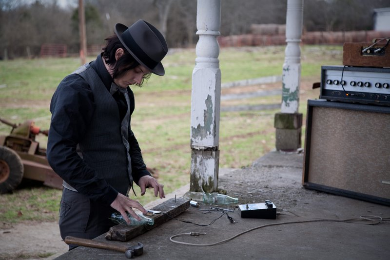 Jack White makes a guitar in the opening of