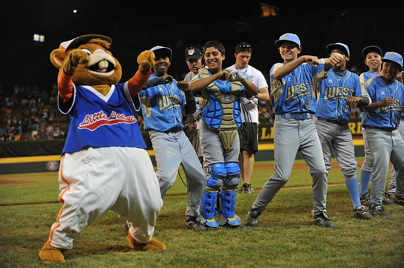 Chula Vista Park View Little League players dance with the Little League masc...