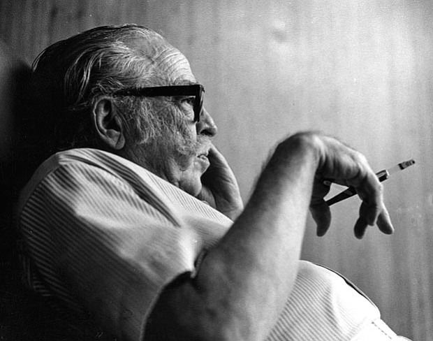 Photo of Dalton Trumbo smoking a cigarette taken in 1971.