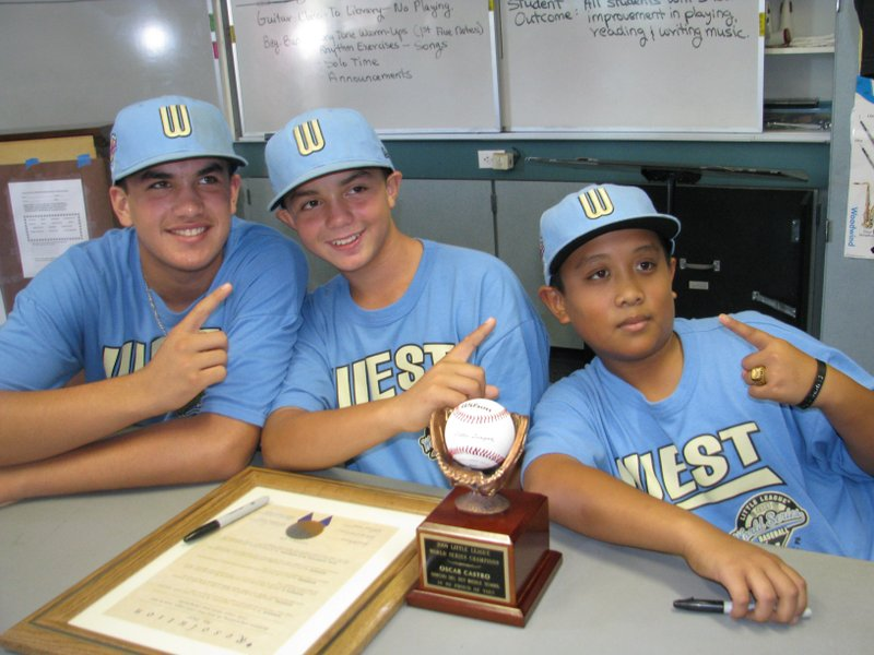 Little League world champs Luke Ramirez, Oscar Castro and Bradley Roberto pos...