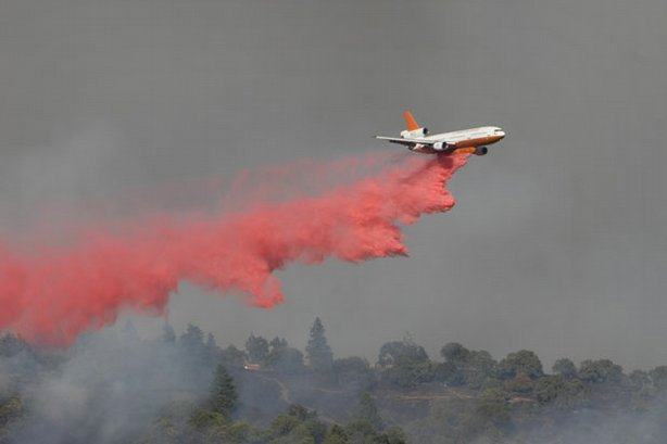 An air tanker drops a load of fire retardant over Henry Coe State Park, Morgan Hill, California.
