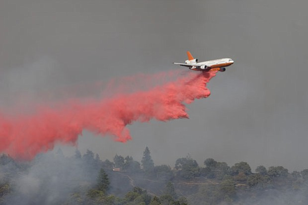 An air tanker drops a load of fire retardant over Henry Coe State Park, Morga...