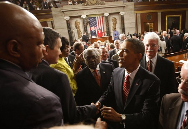 (L-R) Rep. John Lewis (D-GA) and Rep. Dennis Kucinich (D-OH) greet U.S. President Barack Obama after he addressed a joint session of the U.S. Congress at the U.S. Capitol September 9, 2009 in Washington, DC.