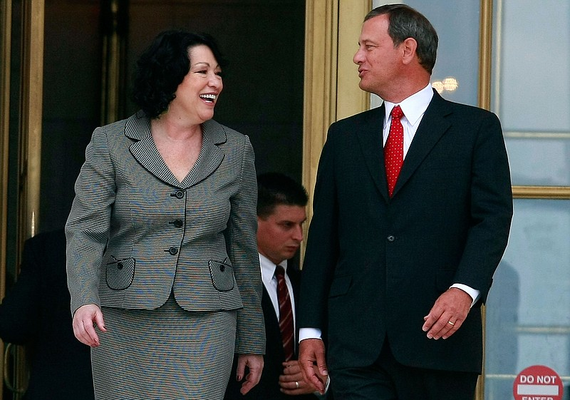 Chief Justice John Roberts (R) and Associate Justice Sonia Sotomayor walk out...