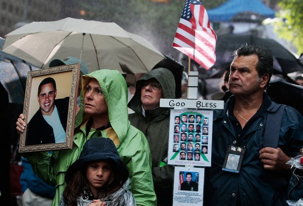Relatives of victims stand before a ceremony marking the eighth anniversary of the 9/11 terrorist attacks on the World Trade Center on September 11, 2009 in New York City.