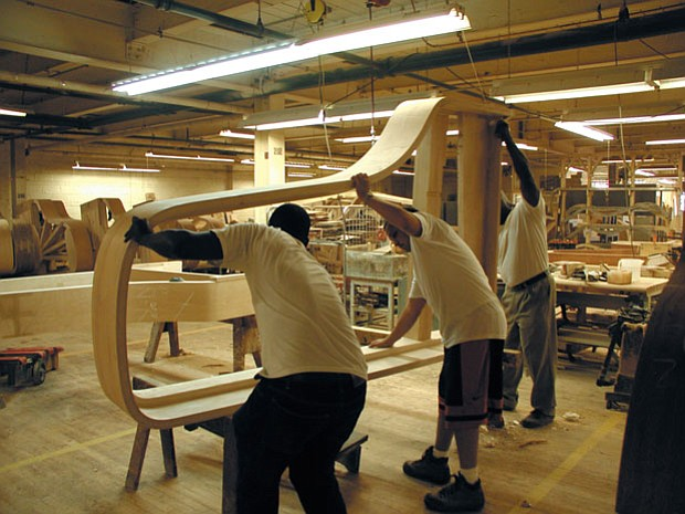 Factory workers manufacturing a Steinway concert grand, #L1037.