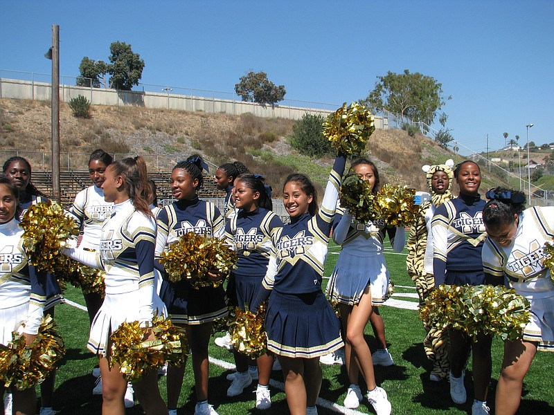 Morse High's cheerleading squad takes part in ribbon cutting ceremony.