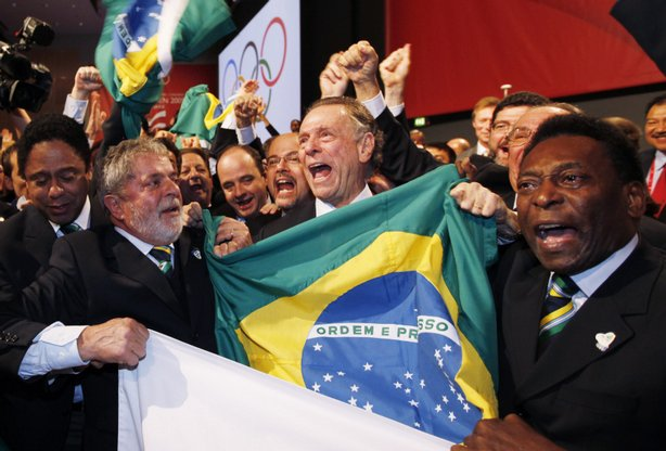 Brazil's President Luiz Inacio Lula da Silva, left, Rio 2016 bid President Carlos Arthur Nuzman, center, and Brazilian soccer great Pele, right, celebrate with their delegation after it was announced that Rio de Janeiro has won the bid to host the 2016 Summer Olympic Games at the Bella Center on October 2, 2009 in Copenhagen, Denmark. The 121st session of the International Olympic Committee (IOC) voted to give Rio de Janeiro the hosting role of the 2016 Olympics over Chicago, Tokyo and Madrid.