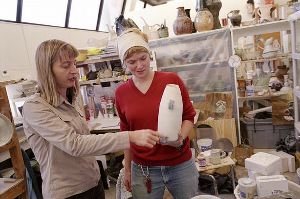 Professor Cary Esser (left) goes beyond teaching skills and techniques, preparing her students for a career in ceramics by mentoring them as they evolve from students to trained professionals. Pictured: Esser working with a ceramics student at the Kansas City Art Institute, Kansas City, Missouri.