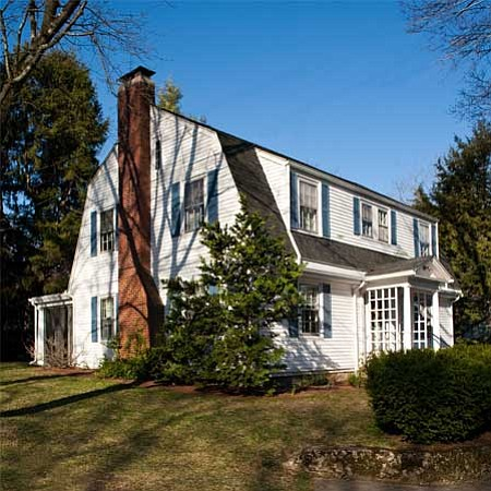 Exterior shot of the 1915 Dutch Colonial Revival owned by Bill and Gillian Pi...