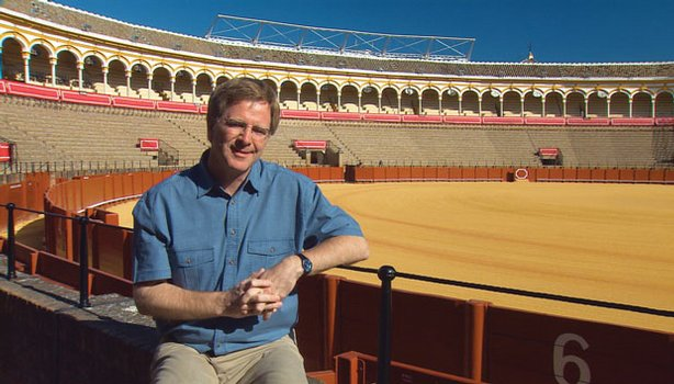 Rick Steves in an empty bullfight ring in Sevilla, Spain.