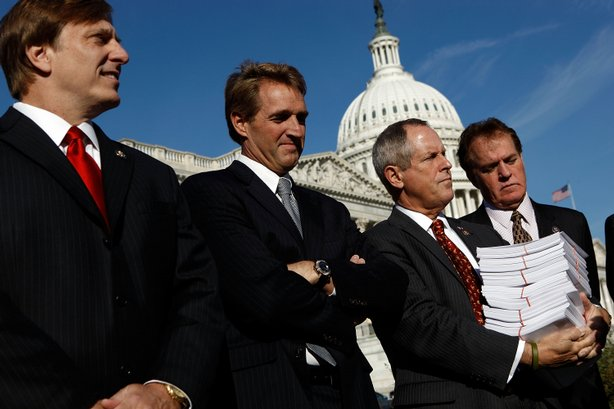 (L-R) Rep. John Fleming (R-LA), Rep. Jeff Flake (R-AZ), Rep. Joe Wilson (R-SC), holding a copy of H.R. 3962 and Rep. Phil Gingrey (R-GA) announce an ammendment to the House version of health reform legislation outside the U.S. Capitol November 4, 2009 in Washington, DC. The ammendment to the 'Affordable Health Care for America Act' would automatically enroll all members of Congress in the 'public option'.