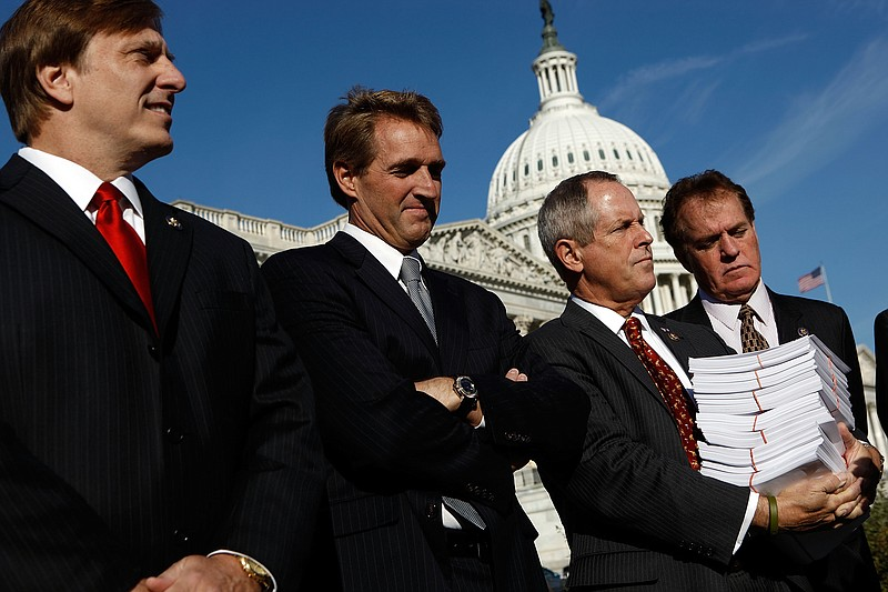 (L-R) Rep. John Fleming (R-LA), Rep. Jeff Flake (R-AZ), Rep. Joe Wilson (R-SC...