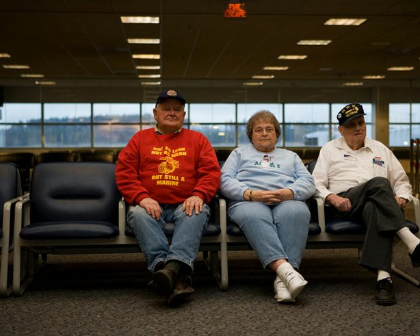 "On call 24 hours a day for the past five years, a group of senior citizens has made history by greeting nearly 800,000 American troops at a tiny airport in Bangor, Maine. ""The Way We Get By,"" airing on Veterans Day, is an intimate look at three of these greeters as they confront the universal losses that come with aging and rediscover their reason for living. Pictured (l-r): Jerry Mundy, Joan Gaudet and Bill Knight at Bangor International Airport."