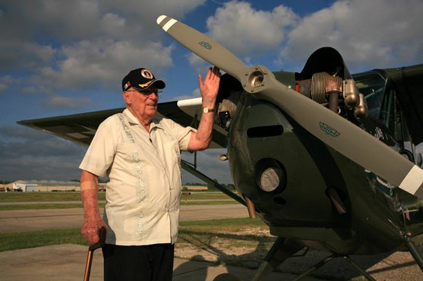 WWII veteran, American Dan Illerich, the sole surviving downed airman rescued by the Dayak tribesmen, pictured in Pearland, Texas, with a L-3 Aeronca, a light aircrft similar to the plane in which he was rescued from Borneo.