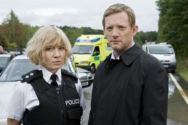 The investigation of a multi-vehicle road accident unravels the shocking secrets of the complete strangers involved, revealing government cover-ups, smuggling, embezzlement, and murder. A remarkable cast portrays the stories of 10 people who share a single defining moment. Pictured: Kate Ashfield as Ann Stallwood and Douglas Henshall as DI John Tolin.