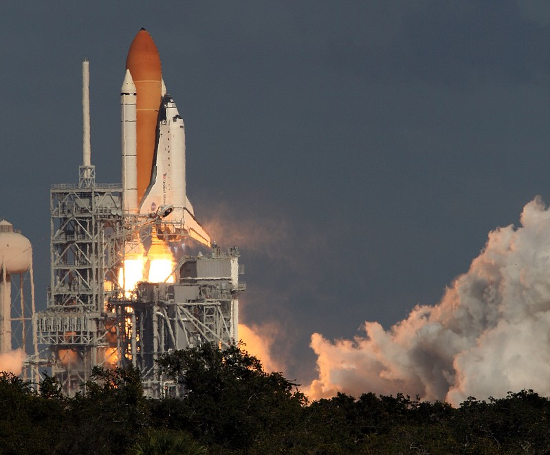 Space Shuttle Atlantis STS-129 blasts off from the launch pad at Kennedy Spac...