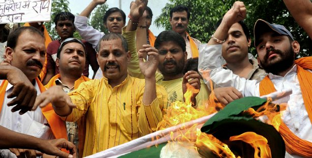 Indian activists of the right-wing Hindu organization Shiv Sena shout slogans...