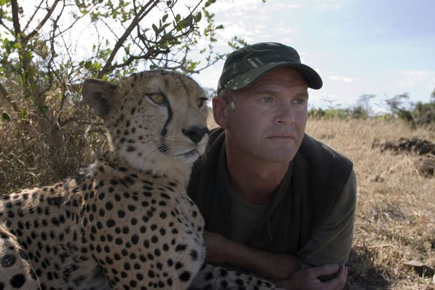 When the mother of two cheetah cubs is killed, a veteran filmmaker becomes th...