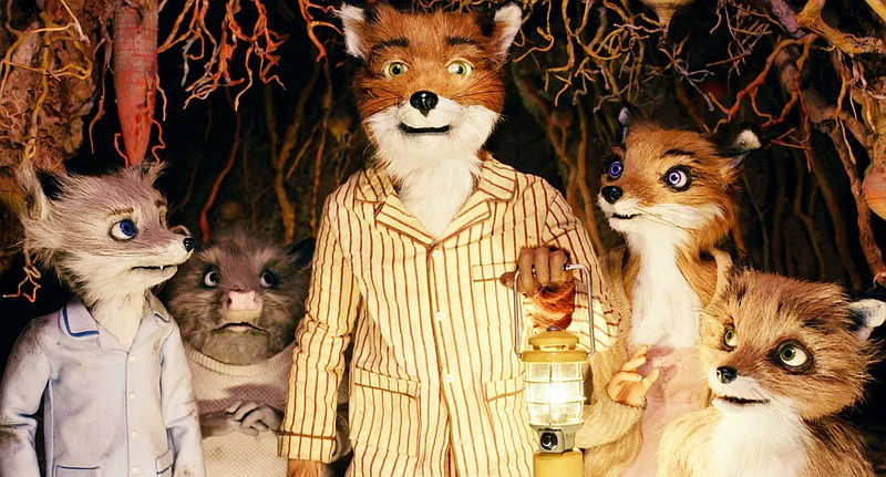 Mr. Fox, voiced by George Clooney, is standing with Mrs. Fox (the voice of Me...