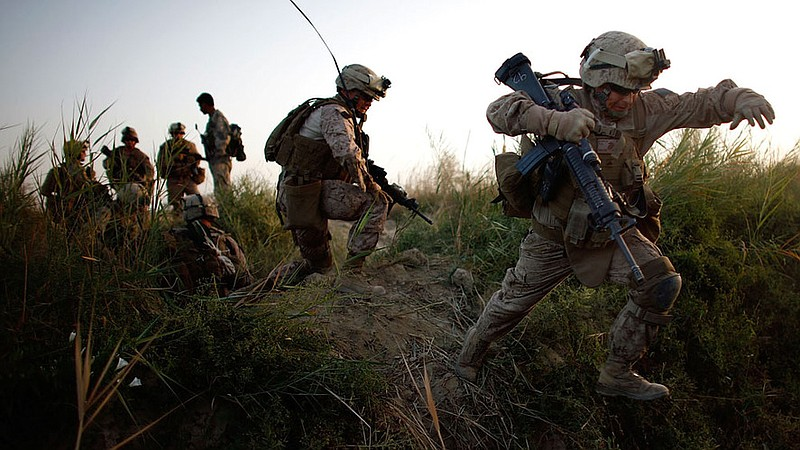 U.S. troops move into Helmand province during a major offensive against the T...