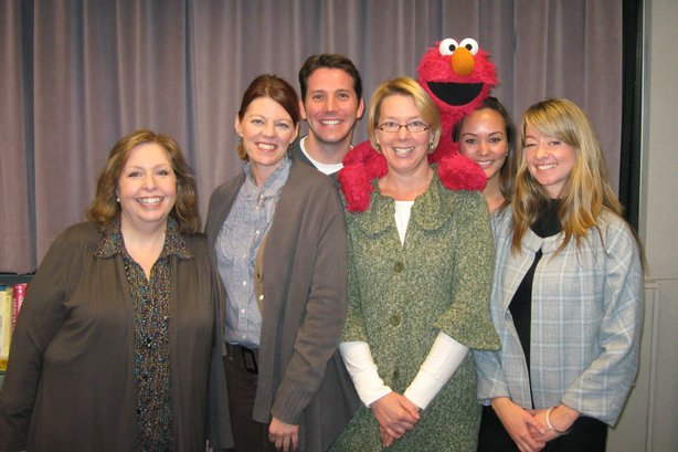These Days team and Elmo. From left, Maureen Cavanaugh, Angela Carone, Hank C...