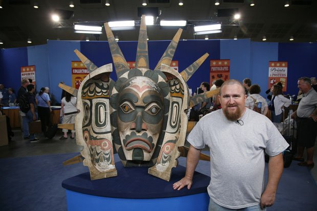 An over-sized, Northwest Coast Indian-style dance mask, carted to