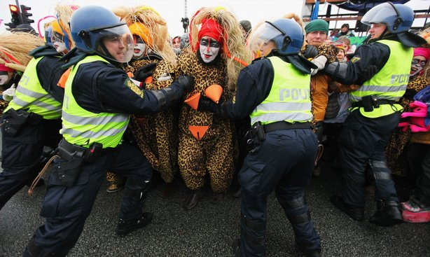 Protestors attempt to break through police lines outside the Bella Centre where the UN climate summit is taking place on December 16, 2009 in Copenhagen, Denmark.