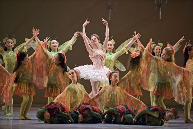 Vanessa Zahorian (center), as the Sugar Plum Fairy, is joined by students of ...