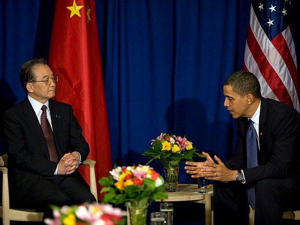 In this photo released by the White House, President Obama talks with Chinese...
