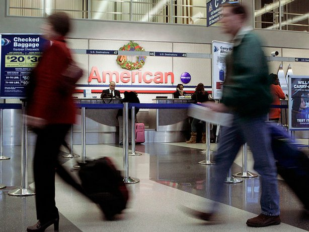Passengers walk to the TSA check-in inside the American Airlines terminal at Chicago's O'Hare International Airport on Nov. 25. Aviation experts say even if the weather cooperates, passengers should be prepared for crowded flights over the Christmas and New Year's holidays.