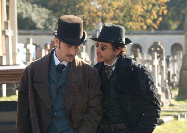 Jude Law and Robert Downey, Jr. as Dr. Watson and Sherlock Holmes