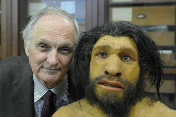 Alda cozies up to an ancient cousin, a Neanderthal, at the American Museum of Natural History.
