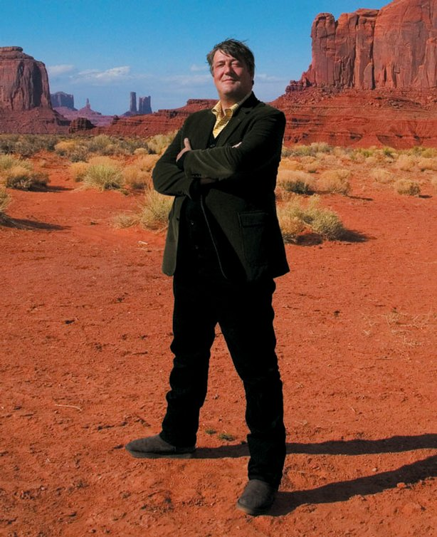 Stephen Fry stands with the desert in the background along his journey across the United States.
