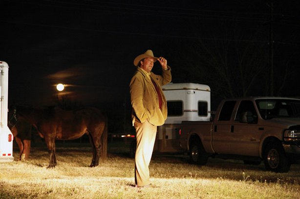Stephen Fry wears a cowboy hat as he stands next to a horse and trailer on hi...